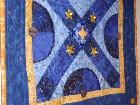 closeup of little star applique and beads