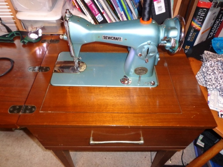 old blue sewcraft sewing machine