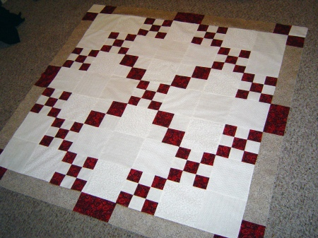 fans and bows quilt top sewn together