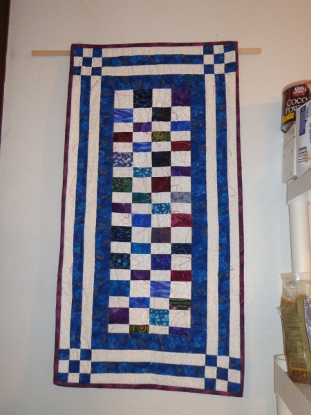 scrappy jewel tone quilt