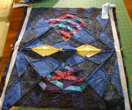 laying both corners on the quilt