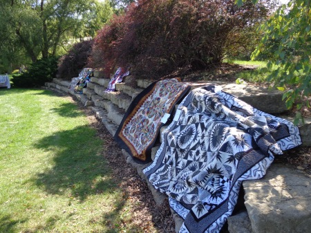 quilts on rocks outside quilt show