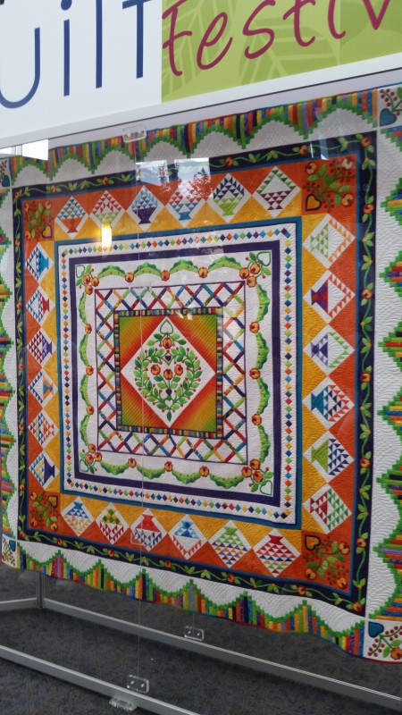 entrance quilt under glass
