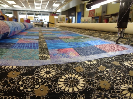 upclose picture of samurai sudoku quilt on longarm