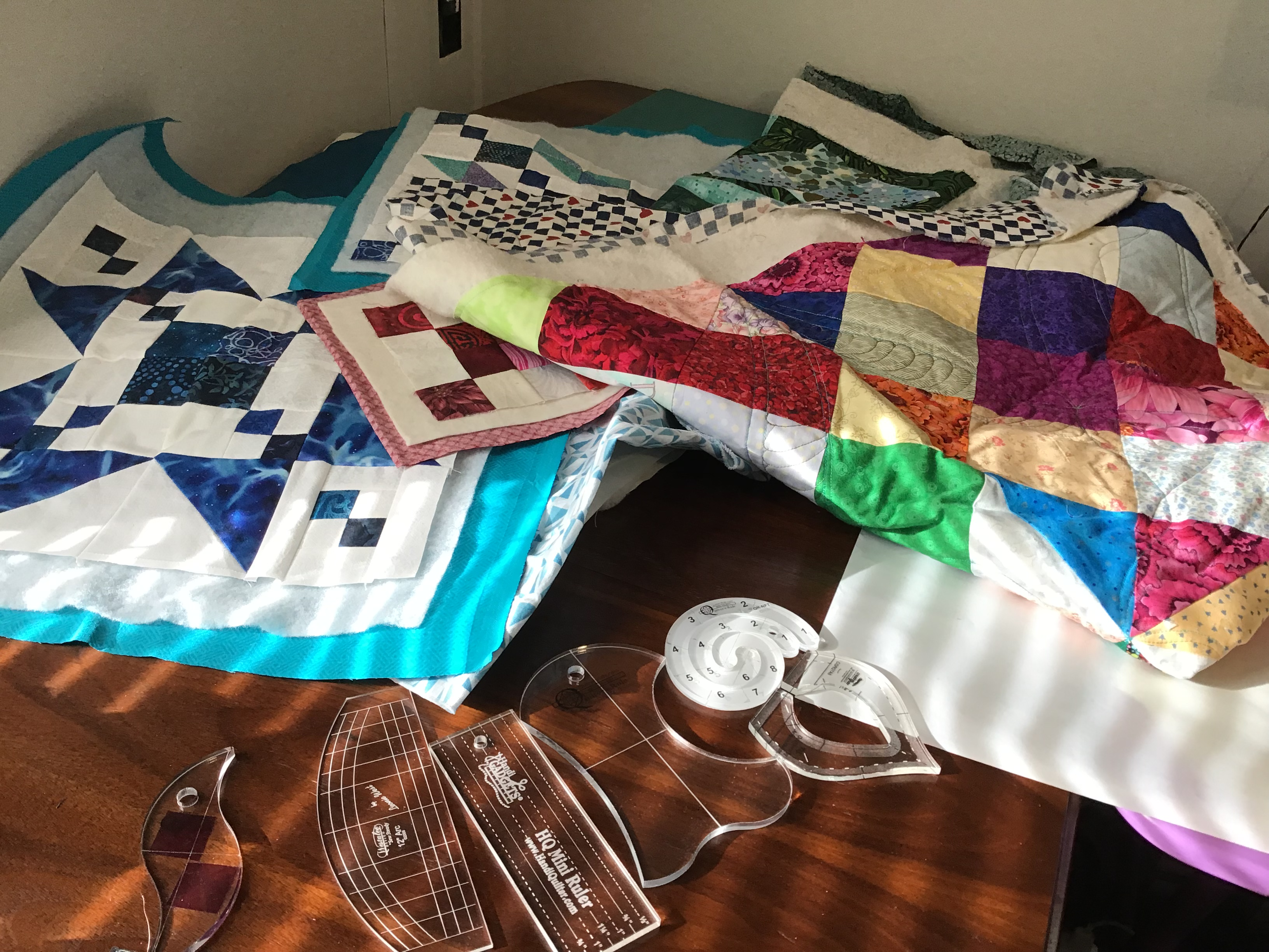What is applique and how is it used in quilts